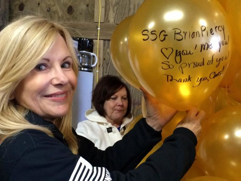 Carol getting ready to release her balloon in honor of her son, Brian